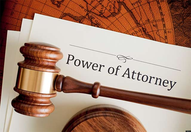 power of attorney document with gavel on top